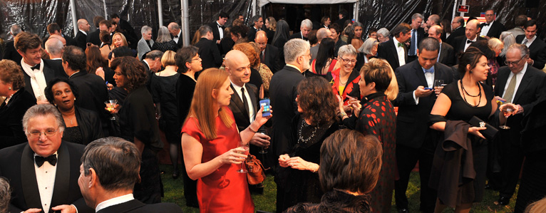 Group of guests at a charity fundraising event using OneCause's Mobile Bidding software