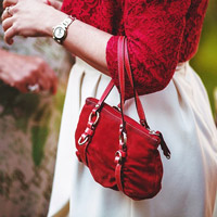 Designer handbags can be the perfect live auction item.