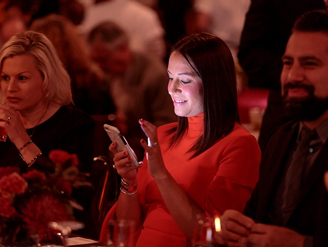 Woman on a mobile phone using OneCause Mobile Bidding and Auction Software