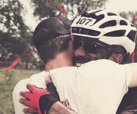 Biker hugging a coach during a peer-to-peer fundraising event.