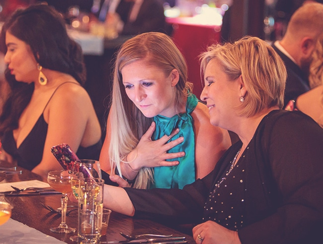 Two Women at an event using OneCause Mobile Bidding Software