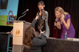 Woman winning a handbag