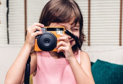 Photography services are one of the most valuable silent auction item ideas for parents.