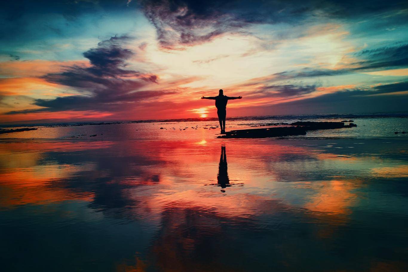 Person Standing Strong With Sunrise